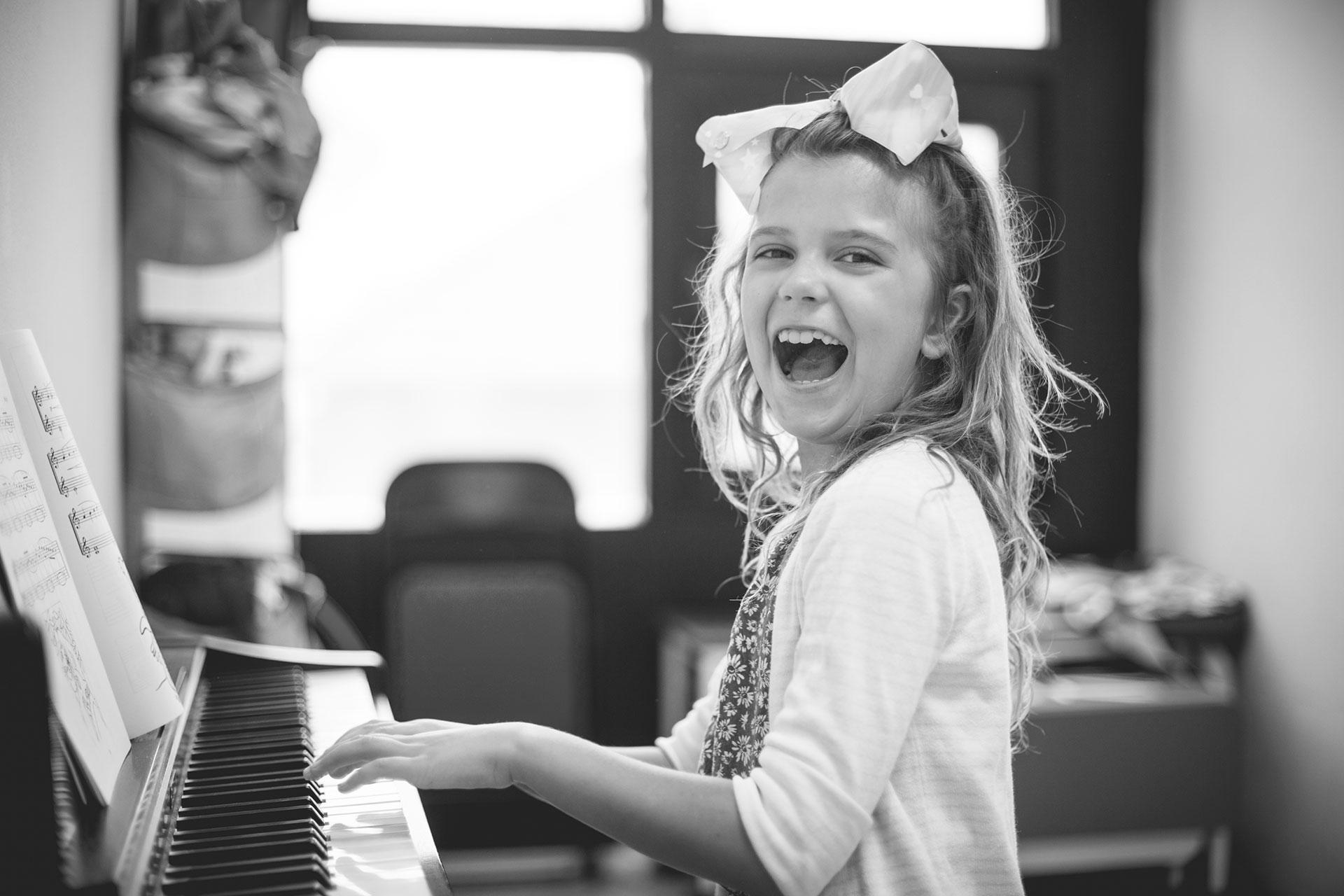 Music-Exams-Happy-Girl-Piano